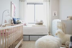 Dannijo's Cofounder Gets Her Dream Nursery - The bed allows Jodie and her husband to still use the room for guests when they need to. Under-bed storage keeps the space tidy and has room for the clothes that Margaux isn't big enough for yet (you know how those baby showers go!). - @Homepolish New York City