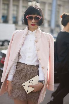 pastel coat, feather skirt and cute clutch