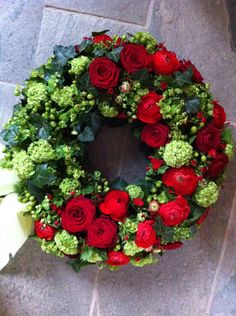 Beautiful spring wreath.  Would try with white roses instead of red.