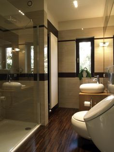 Dark Wood Floors With Glass Enclosed Shower