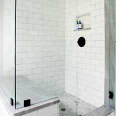 White Tile Walk-In Shower With Glass Walls and Sitting Bench