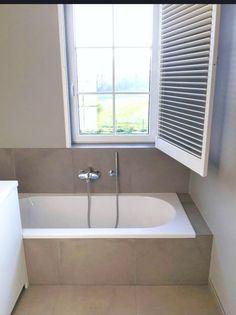 Badkamer met keramische tegels  www.vl-construct.be