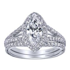 18k White Gold Contemporary Halo Engagement Ring Pretty...I don't usually like any that I see...
