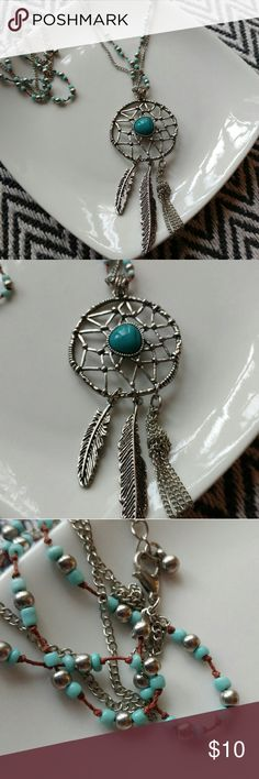 """Silver dreamcatcher necklace Silver dreamcatcher necklace with teal beads. Great condition, never worn. Roughly 20"""" long. Pendant is roughly 5"""" long and  2"""" wide. Adorable piece. Jewelry Necklaces"""