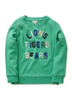 100% Cotton Sweater. Rugby quality, raglan sweater. Features felt applique slogan on front. Flatlocked seams throughout, with ribbed crew neck, sleeves and hem. Regular fit, available in Jade.
