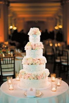 Pale blue wedding cake with pink and cream flowers