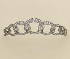 And a simple diamond tiara of interlocking cirlces, 1910.