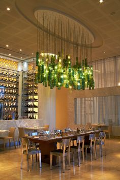 These elongated green lights both light up the dining room and add an eye-catching design at Yas Viceroy's Restaurant Amici.