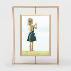 When you're looking for some unique style for your photo display, bring some mid-century modern vibes into your space with the Single Image Frame from Project 62™. With a brass-colored finish, this metal picture frame can be set up horizontally or vertically, so you can display a sunset vacation photo or your favorite picture of you and your best friend.<br><br>1962 was a big year. Modernist design hit its peak and moved into homes across the country. And in Minnesota...