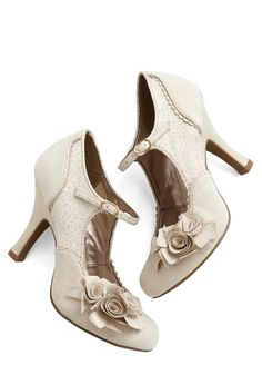 Picture Glitz Heel, #ModCloth-- Envision an evening with swooning romance, sips of white wine, and these ladylike heels. These eggshell-toned Mary Janes boast star gilded-brocade vamps, a scalloped trim, and an off-centered bouquet of flowers upon their closed toes. We can't imagine a shoe more perfect!