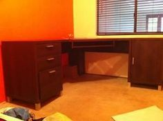 Dark wood corner desk. Has 3 drawers (one of them is a filing draw) and a storage cupboard. Also has a retractable shelf for keyboard.