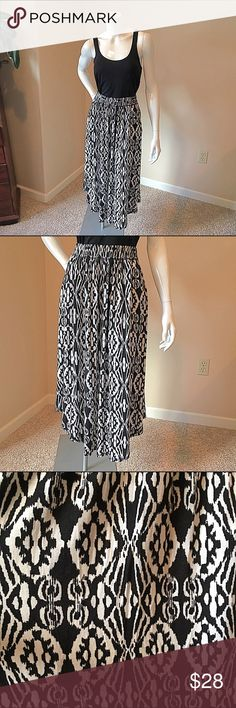 Postmark Anthropologie S Black white ikat skirt Postmark Anthropologie size small black and white ikat print skirt. Super comfortable jersey material with an elastic waist band. Waist 12 inches with stretchy elastic, length 31 inches in the center which is its longest point. 95% rayon 5% spandex. Anthropologie Skirts Midi