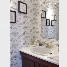 A big fan of this room shot image showing our 'Tribe' wallpaper working so well in a clients bathroom. #wallpaper #wallcoverings #impala #safari #africa #design #detail #inspiration #interiordesign #homedecor #bathroom #mirror #reflection #metallicwallpaper #monochrome