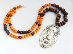 African Tribal Mask Necklaces Mens Jewelry Ethnic Orange Brown Afrocentric Silver Face Wood Beaded Large Pendant by TheBlackerTheBerry