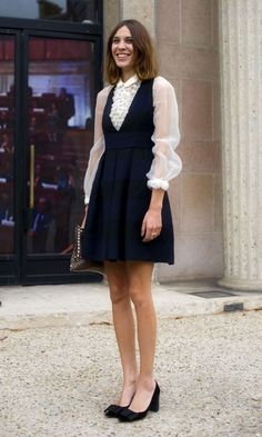 Alexa Chung Looks Pretty In A White Shirt And Black Dress At Paris Fashion Week, October 2011
