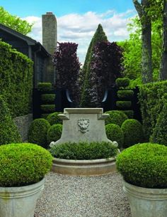 Landscape designer Joseph Cornetta. A French fountain greets visitors in the courtyard, formerly the driveway, while dark red beech trees stand sentry behind a gate.