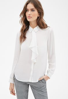 If you prefer your essentials with a feminine twist, this long-sleeved blouse is for you. It's crafted from an airy chiffon with a buttoned front and a basic collar, but it's the girly ruffle accent on its front that you'll love most.