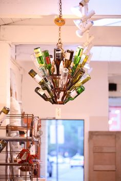 Wine bottle chandelier for the patio.