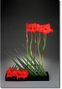 """Came up with something like this with the florist...not so much red, and not so """"linear"""", and with a round, white bottom vase.  But love the ikbana..."""