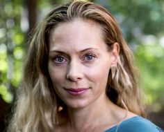 Eva Röse wearing Triangle earrings Cooee