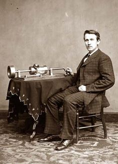 Photograph of Thomas Edison with his phonograph (2nd model), taken in Mathew Brady's Washington, DC studio in April 1878.