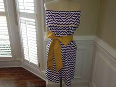 Si cest la saison de football, recrutement de sororité ou nimporte quel jour ordinaire cette robe sans bretelles, ébouriffée avec une