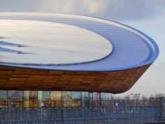 The lightweight, double-curving, cable-net roof structure was designed to reflect the shape of the cycling track.