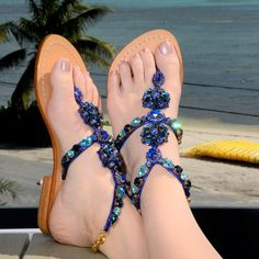 - Flat Sandals - Genuine High Grade Leather - Swarovski type Bohemian crystals by Preciosa - Carefully selected Asian stones - Handmade in Indonesia - Fantastic golden gift shoe box (collapsible) Our shoes are running small and we recommend ordering one size up, especially from size US Women's 7 and up. Please check SIZE & FIT before ordering.