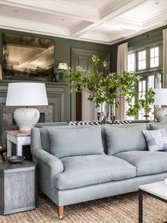 Love the wall mouldings and dramatic detailed ceiling in this formal living…