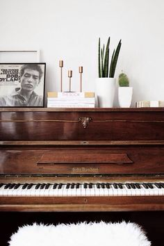 frame old record and use coffee table books to decorate piano top