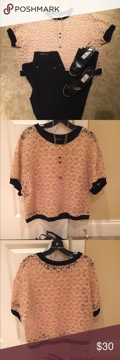 ❣DKNY lace top❣ DKNY beige lace top  with black trim at neckline, hem and sleeves. Has a boxy look and needs a tank under with. Dress it up or down.. Creates a classic look!! DKNY Tops