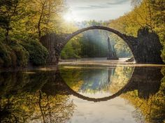 This 19th-century bridge creates a perfect stone circle when reflected in the still waters below it.