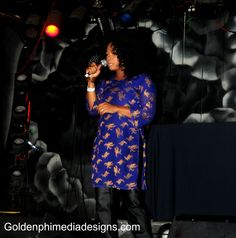 Me in colbolt and gold brocade, leather trousers (vintage) performing in Phx.
