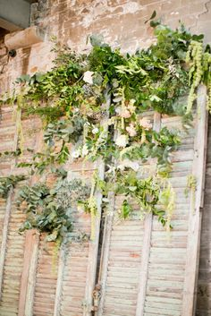 Foliage Backdrop on Vintage Shutters // Crisa and Gareth MC Motors Warehouse Wedding - Photography by Caught The Light, Planning by London Bride, Flowers by Bo Boutique