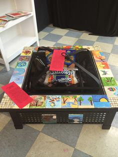 Class Auction Project - fire pit framed with kid's hand-painted tiles and filled with s'mores fixins.