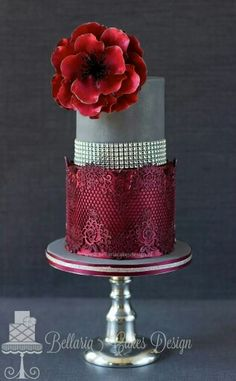 Amazing cake. Red sequins, bling and a stunning flower!