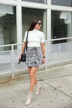 Pin for Later: 47 Easy-Breezy Spring Outfits You Can Wear to Work An Asymmetrical Skirt and Crisp Shirt With Leather Booties