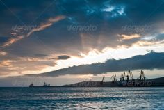 Morning in harbor. ...  Expressing, background, beauty, blue, cargo boat, cloud, cloudscape, color, crane, dawn, day, dock, dramatic, edge, harbor, harbour, heaven, horizon, horizontal, in, life, light, moody, morning, nature, new, nobody, orange, outdoor, over, port, ripple, rippled, sea, seascape, ship, sky, sun, sunlight, sunrise, travel, tropical, vessel, vibrant, waking, water, wave