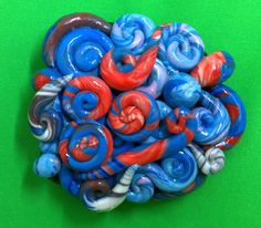 Decorated stone, unique creation with abstract motifs in blue and red. Polymer clay. by MarianCreaciones on Etsy https://www.etsy.com/ca/listing/486816465/decorated-stone-unique-creation-with