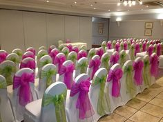 Celebration Events - white lycra covers with alternating hot pink & lime green sashes :)