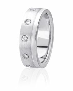 Diamonds Are Flush Set Off Center To Create A Eternity Band Feel For Both Men & Women