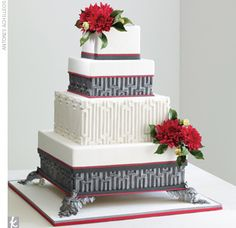 Wedding Cake Trend #4: Dramatic Color    A charcoal and white Art Decor pattern calls for a couple of natural accents, such as bright red chrysanthemums.     Cake: Ron Ben-Israel, New York, NY
