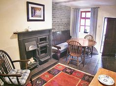 Picture. Swan cottage Maryport. dogs ok  don't have £ not sure seems to be always booked but looks fab.