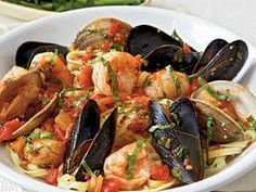 """Italian for """"angry,"""" arrabbiata is a spicy tomato sauce. For true fury, use 1/2 teaspoon crushed red pepper in this delicious seafood dish."""