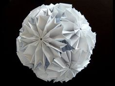 Love this cherry blossom ku-kusudama. I think just a single flower would be neat as a package topper!