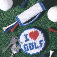 """Finding a unique gift """"fore"""" a golfer is in the bag--with this miniature golf bag, that is! Paired with the matching key ring, the combo makes nice tokens, party favors, or Father's Day gifts for fans of the fairway. The designs are stitched using worsted weight yarn and 7 mesh plastic canvas. <p><strong>Number of Designs:</strong> 2 - Mini Golf Bag & Key Ring </p><p><strong>Approximate Design </p><p><strong&g..."""