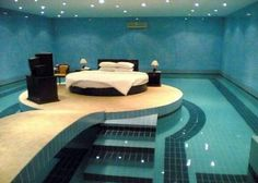 bedroom with round bed and pool