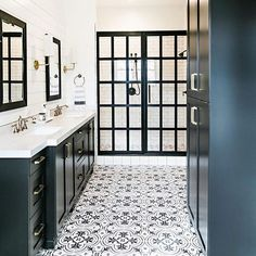 A #bathroom with personality and fresh ideas! Isn't this #modernfarmhouse bathroom great? The #black #cabinets are @BenjaminMoore Black Beauty. The framed #shower is custom. Design by the talented @sitamontgomeryinteriors #onetofollow #bathroomdesign #farmhousebathroom #cementtile #tile #Cabinet #PaintColors #paintlikenoother #homedesign #mydomained #houzz #HGTV #Interiordesigner #interioroftheday