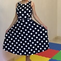 navy polka dot midi dress A closet stable with this navy polka dot midi dress! Dress it up as an uptown girl or wear it as a picnic dress. 95% polyester 5% spandex. Made in USA. Also available in ivory in another listing 12PM Dresses Midi