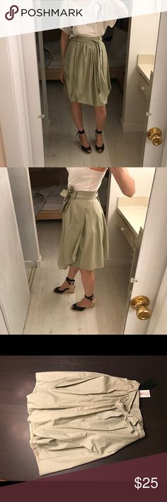 """Khaki bubble flare asymmetrical pleated midi skirt Khaki pleated skirt with extra fabric in the front to form an asymmetrical bubbled look. Includes belt and a hidden zipper with two buttons in the back. High quality cotton. No size tag but fits like a small. Unique design. Waist measures approximately 13 1/2"""" laying flat. About 22"""" long. Non stretch fabric. Skirts A-Line or Full"""
